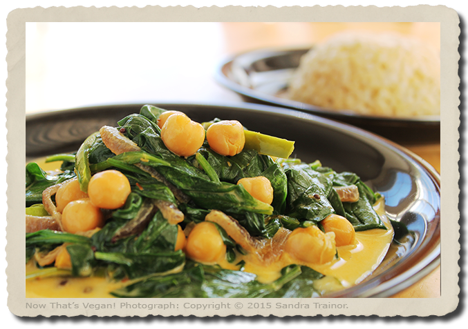 A recipe for a spinach and chickpeas in an Indian spiced sauce.