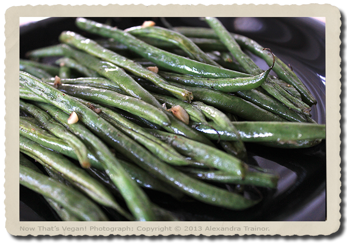 French greanbeans with garlic and shallots, coated in seasoned oil before roasting.