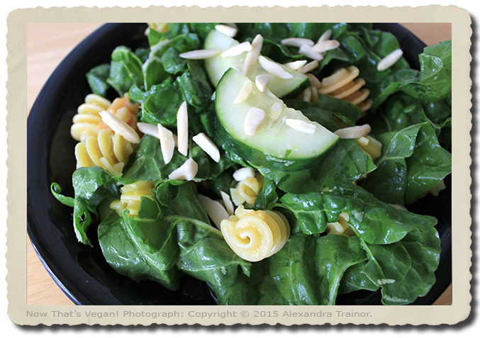 A tasty salad made with green chard, cucumber, and gluten-free pasta.