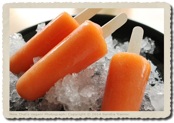 Popsicles made with mango and strawberries.