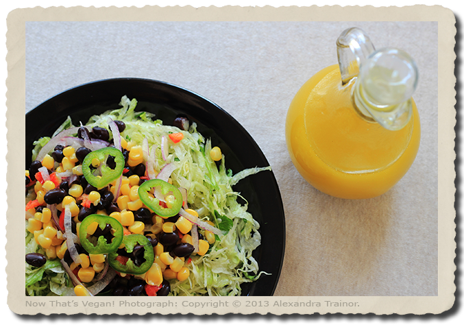 A shredded lettuce salad with Mexican toppings and citrus dressing.