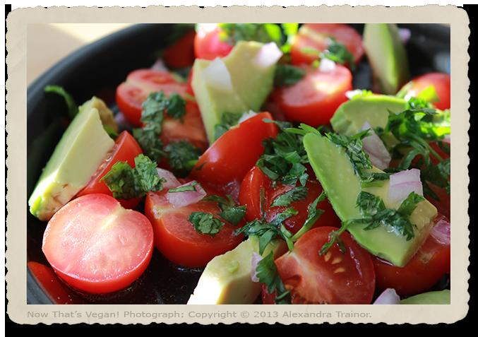 A salad made with tomatos and avocados.