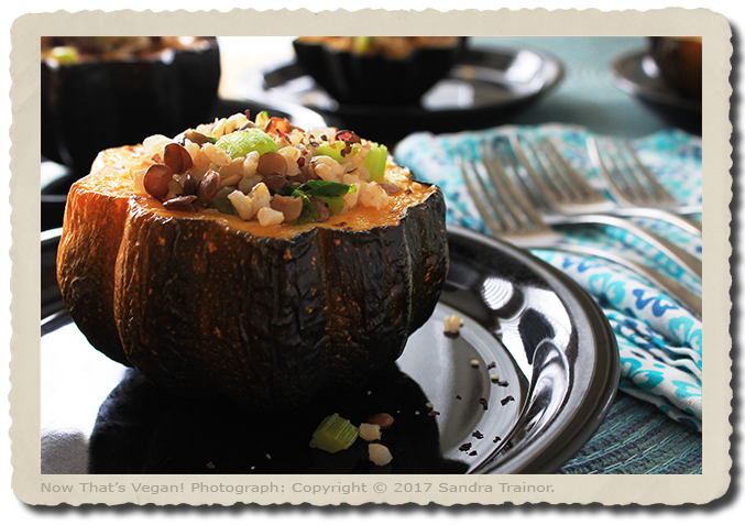 Acorn squash stuffed with brown rice and lentils.