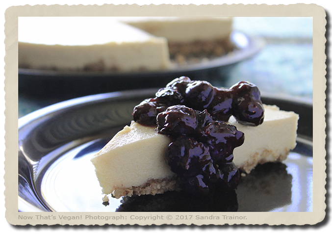 A vegan cheesecake topped with blueberries.