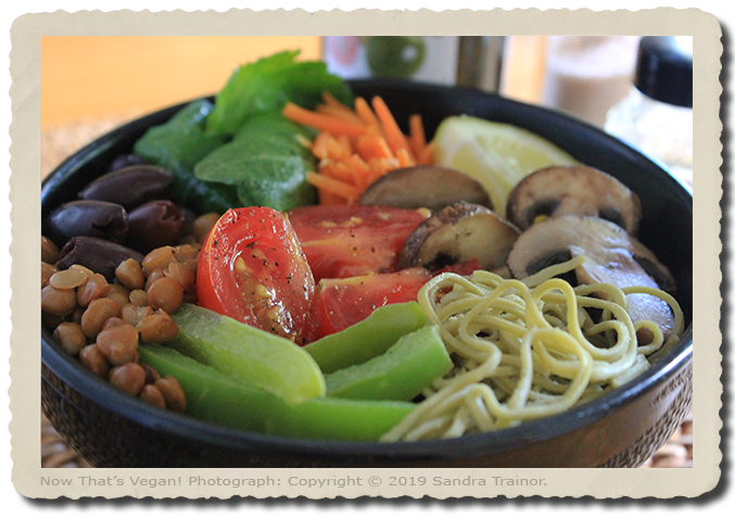 A meal in a bowl made with veggies and pasta.